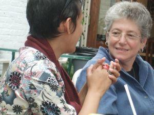 Dr. Helen Langa talks with Maria